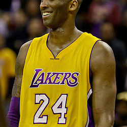 Feb 4, 2016; New Orleans, LA, USA; Los Angeles Lakers forward Kobe Bryant (24) laughs during a timeout in the fourth quarter of a game against the New Orleans Pelicans at the Smoothie King Center. The Lakers defeated the Pelicans 99-96. Mandatory Credit: Derick E. Hingle-USA TODAY Sports