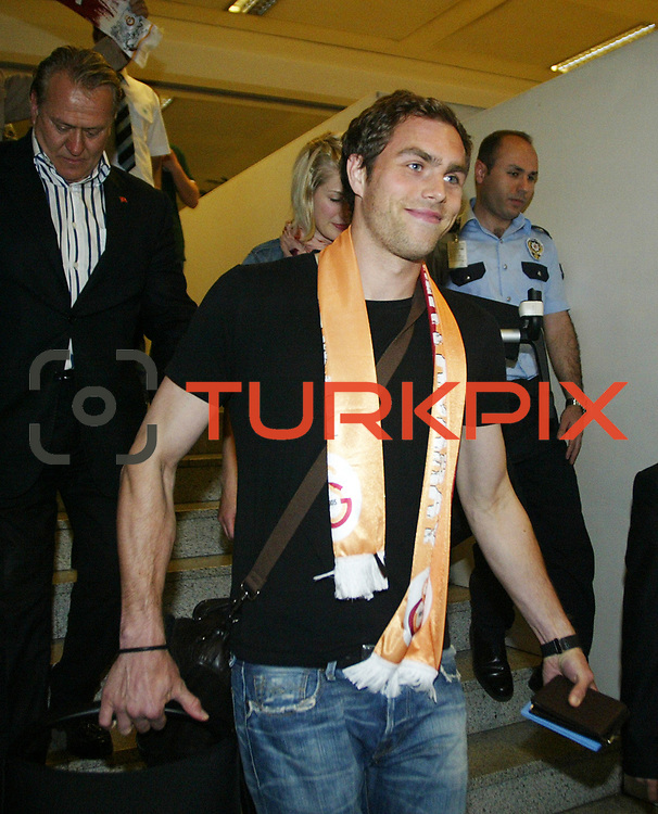 Bolton Wanderers' Swedish International forward, Turkish soccer club Galatasaray new player Johan ELMANDER, is surrounded by supporters and officials upon his arrival at Ataturk Airport in Istanbul Turkey on Friday 27 May 2011. Galatasaray, Barclays Premier League soccer team Bolton Wanderers forward played with a four-year deal gave Johan ELMANDER. Photo by TURKPIX