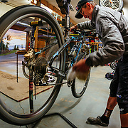 Chris Cook throws a tune on his 29 inch wheeled mountain bike after a late afternoon ride in Eagle, Colorado.