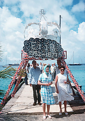 Queen Elizabeth arrives in Mustique and is welcomed by Princess Margaret in 1977.