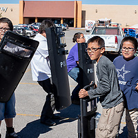 Community members get to learn how the Gallup Police Department uses their swat and riot gear at the 6th Annual Preparedness and Public Safety Day, Saturday at the Rio West Mall.