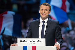 Presidential election candidate for the En Marche ! movement Emmanuel Macron raises his fists on stage as he delivers a speech during a campaign meeting on April 17, 2017 at the Bercy Arena in Paris. Macron planned his biggest rally yet at the Bercy sports and concert hall, a venue with a capacity of 20,000. The location near the economy ministry serves as a reminder that the relatively inexperienced Macron held the key economy portfolio for two years under his mentor Hollande. Photo by ABACAPRESS.COM