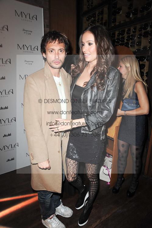 DAN MACMILLAN and SASHA VOLKOVA at a party to celebrate the 10th anniversary of the Myla lingerie brand held at Almada, 17 Berkeley Street, London on 17th November 2010.
