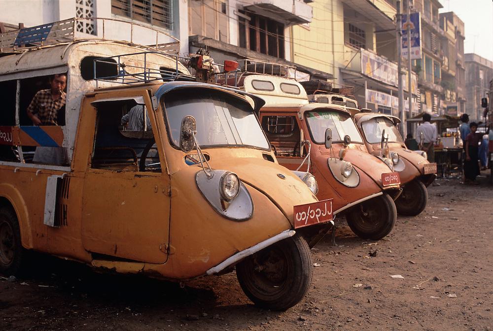 Bago(Pegu) City scene, three wheeled taxis
