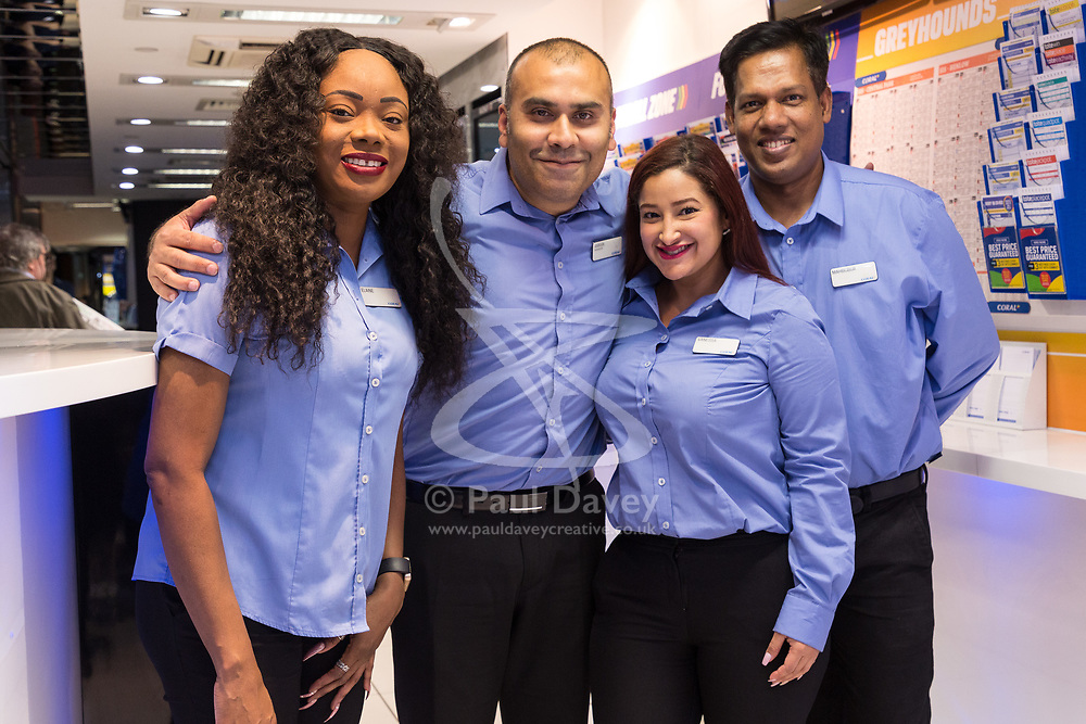 Betting Shop Manager-of-the-Year finalist Amran Al-Haque poses with team members, Elaine Norbert, Vanessa Lopez Mahbubur Rahman at Coral, 1 Canada Square, Canary Wharf, London, November 08 2018.