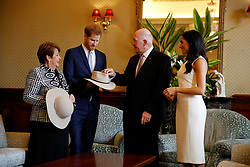 The Duke and Duchess of Sussex look at bush hats with Australia's Governor General Peter Cosgrove and his wife Lynne Cosgrove at Admiralty House in Sydney on the first day of the royal couple's visit to Australia.