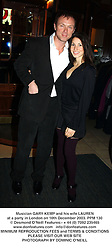 Musician GARY KEMP and his wife LAUREN at a party in London on 10th December 2003.PPM 130