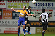 Ollie Rathbone wins a header during the EFL Cup match between Mansfield Town and Rochdale at the One Call Stadium, Mansfield, England on 8 August 2017. Photo by Daniel Youngs.