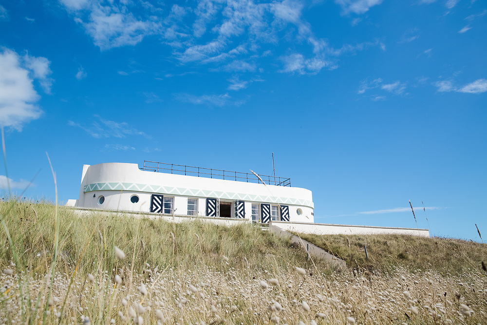 The Heritage self catering accommodation, the Barge Aground, with its beachfront location in summer in Jersey, CI