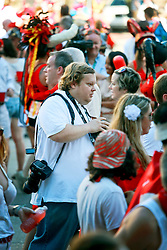 12 July 2014. New Orleans, Louisiana.<br /> Matthew Hinton of the Advocate scythes his way through the crowds at the 8th annual San Fermin in Nueva Orleans, the annual Encierro (bull run) festival paying homage to the world famous Encierro of Pamplona, Spain<br /> Photo; Charlie Varley/varleypix.com