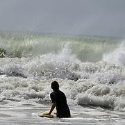 A surfer in the water at Oakura Beach, Taranaki, on Surf Highway 45. Taranaki, New Zealand,, 23rd December 2010.  Photo Tim Clayton