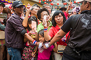01 FEBRUARY 2014 - BANGKOK, THAILAND: People wait to donate money to anti-government protest leader Suthep Thaugsuban in the Chinatown section of Bangkok. The anti-government protest movement, led by the People's Democratic Reform Committee (PDRC) organized a march through the Chinatown district of Bangkok Saturday and disrupted the city's famous Chinese New Year festival. Some streets were blocked and Suthep walked through the neighborhood collecting money. The march was in advance of massive protests the PDRC has promised for Sunday, Feb. 2 in an effort to block Thais from voting in the national election.     PHOTO BY JACK KURTZ