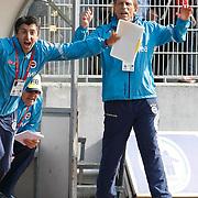 Fenerbahce's coach Christoph DAUM (R), Roland KOCH (C), Ayhan TUMANI (L) celebrate goal during their Turkish superleague soccer match Kasimpasaspor between Fenerbahce at the Recep Tayyip Erdogan stadium in Istanbul Turkey on Sunday 25 April 2010. Photo by Aykut AKICI/TURKPIX