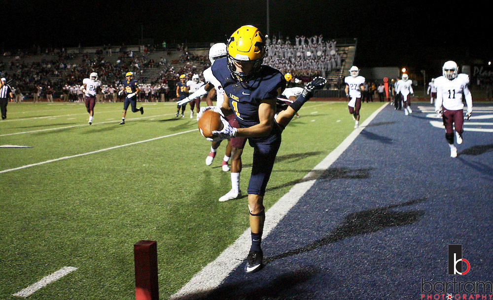 McKinney's Quentin Quirrenbach scores during a game between McKinney High and Plano Senior High on Friday, Sept. 30, 2016 at Ron Poe Stadium in McKinney. It was McKinney High's homecoming game. McKinney won 31-28. (Photo by Kevin Bartram/buzzphotos.com