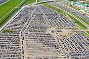 Nederland, Noord-Holland, Haarlemmermeer, 09-04-2014; luchthaven Schiphol met A4 en Schipholtunnel. Personeelsparkeerterrein P40.<br /> Schiphol Airport with longterm parking.<br /> luchtfoto (toeslag op standard tarieven);<br /> aerial photo (additional fee required);<br /> copyright foto/photo Siebe Swart.