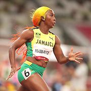 TOKYO, JAPAN August 2:   Shelly-Ann Fraser-Pryce of Jamaica in action during the 200m semi finals for women during the Track and Field competition at the Olympic Stadium  at the Tokyo 2020 Summer Olympic Games on August 2nd, 2021 in Tokyo, Japan. (Photo by Tim Clayton/Corbis via Getty Images)