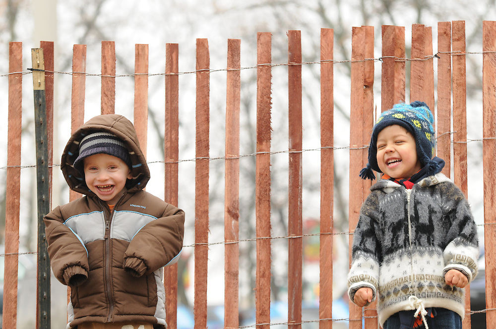 Andrea, Brian, and Jack Morowczynski are photographed by Aimee Clark, who's family of Nick, Miles, and Aurora are, in turn, photographed by Brian Morowczynski at Chicago's Caldwell Woods.