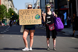 "© Licensed to London News Pictures. 22/04/2019. LONDON, UK.  Activists walk down Oxford Street to Marble Arch during ""London: International Rebellion"", on day eight of a protest organised by Extinction Rebellion.  Protesters are demanding that governments take action against climate change.  After police issued section 14 orders at the other protest sites of Oxford Circus, Waterloo Bridge and Parliament Square resulting in over 900 arrests, protesters have convened at the designated site of Marble Arch so that the protest can continue.  Photo credit: Stephen Chung/LNP"