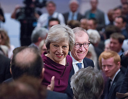 Prime Minister Theresa May and husband Philip John May walk out the hall after delivering her main speech to delegates in the final day of the Conservative party conference at the International Convention Centre, ICC, Birmingham. Wednesday October 5, 2016. Photo credit should read: Isabel Infantes / EMPICS Entertainment.