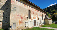 """Exterior of the Church of San Vigilio in Pinzolo and its fresco paintings """"Dance of Death"""" painted by Simone Baschenis of Averaria in1539, Pinzolo, Trentino, Italy .<br /> <br /> Visit our MEDIEVAL ART PHOTO COLLECTIONS for more   photos  to download or buy as prints https://funkystock.photoshelter.com/gallery-collection/Medieval-Middle-Ages-Art-Artefacts-Antiquities-Pictures-Images-of/C0000YpKXiAHnG2k<br /> If you prefer to buy from our ALAMY PHOTO LIBRARY  Collection visit : https://www.alamy.com/portfolio/paul-williams-funkystock/san-vigilio-pinzolo-dance-of-death.html ."""