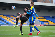 AFC Wimbledon striker Joe Pigott (39) battles for possession during the EFL Sky Bet League 1 match between AFC Wimbledon and Lincoln City at Plough Lane, London, United Kingdom on 2 January 2021.