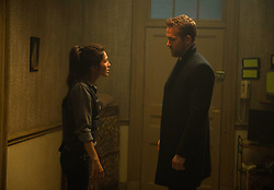 """Elodie Yung as """"Amelia Roussel"""" and Ryan Reynolds as """"Michael Bryce"""" in THE HITMAN'S BODYGUARD. Photo by Jack English."""