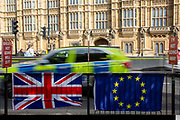 The EU flag and Union Jack attached to the barrier by the pro EU demonstrators who have been outside parliament on a daily basis since September 2017 after the country voted to leave the European Union. House of Commons, Westminster, London, United Kingdom
