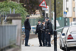 © Licensed to London News Pictures. 14/11/2017. London, UK. Police officers within the police cordon at Monteagel Way, Nightingale Estate in Hackney this morning. Police were called by London Ambulance Service to reports of a stabbing at Monteagle Way, Nightingale Estate in Hackney at around 0001hrs today. At the scene a 21-year-old male was treated by medical professionals for a stab wound to the chest. The man died at the scene at 0015hrs. Photo credit: Vickie Flores/LNP