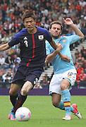 Men's Olympic Football match Spain v Japan on 26.7.12...Takahiro Ohgihara of Japan and Juan Mata of Spain, during the Spain v Japan Men's Olympic Football match at Hampden Park, Glasgow...Picture John Millar / ProLens PhotoAgency / PLPA.Thursday 26th July 2012......................