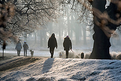 © Licensed to London News Pictures. 23/01/2015. Richmond, UK. People in the cold air.  A cold frosty morning in Richmond Park, Surrey today 23rd January 2015. The UK is experiencing some very cold weather. Photo credit : Stephen Simpson/LNP