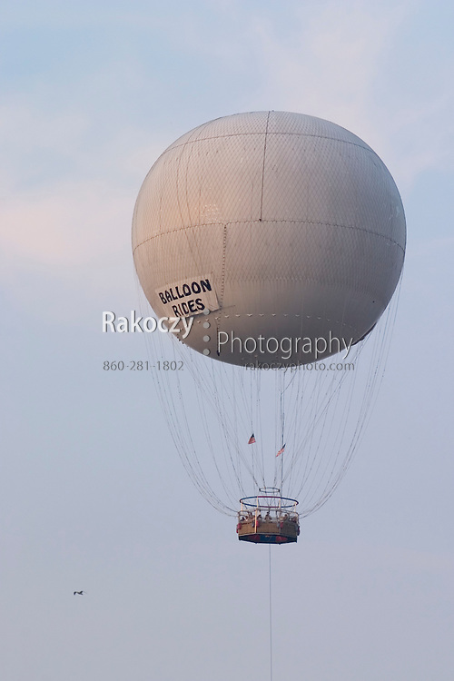 A large balloon lifts tourists high above the ground for views of the scenery.