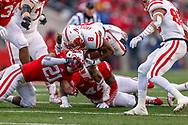 Ameer Abdullah is toppled by Wisconsin defenders during Nebraska's 59-24 loss at Wisconsin on Nov. 15, 2014. © Aaron Babcock