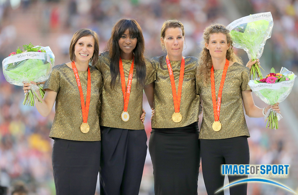 Sep 9, 2016; Brussels, Belgium; Members of the Belgian women's 4 x 100m relay (from left), Kim Gevaert, Elodie Ouedraogo, Hanna Marien and Olivia Borlee  pose with gold medals from the 2008 Beijing Olympics after they were upgraded after a Russian sprinter was disqualified for drugs in the 41st Memorial Van Damme at King Baudouin Stadium. Photo by Jiro Mochiuzki