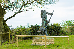 © Licensed to London News Pictures. <br /> 23/4/2017. London, Great Britain.  <br /> Statue of naked Greek philosopher, Archimedes in the grounds of College Farm, Ellisfield, Basingstoke which is being objected to by residents who claim it is a distraction to drivers. <br /> Photo credit: Anthony Upton/LNP
