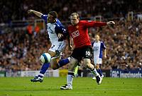 Photo: Richard Lane/Sportsbeat Images.<br />Birmingham City v Manchester United. The FA Barclays Premiership. 29/09/2007. <br />City's Stephen Kelly challenges United's Wayne Rooney.