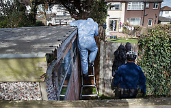 © Licensed to London News Pictures. 14/03/2018. London, UK. Police wearing protective clothing enter the back garden of the house of Russian exile Nikolai Glushkov as they continue their investigation in south west London. Mr Glushkov, a friend of oligarch Boris Berezovsky, and a former deputy director of Russian state airline Aeroflot, died at his home in Monday night. Photo credit: Peter Macdiarmid/LNP