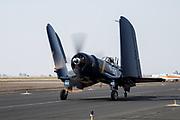Chance-Vought F4U-7 Corsair of Erickson Aircraft Collection taxiing.