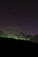 The Aurora just shows over a ridgeline with the Big Dipper in the sky above