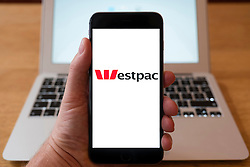 Using iPhone smartphone to display logo of Westpac, Australian bank and financial-services provider