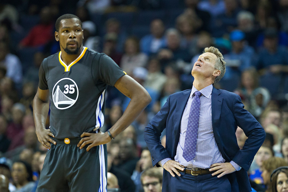 MEMPHIS, TN - DECEMBER 10:  Kevin Durant #35 and Head Coach Steve Kerr of the Golden State Warriors watch a replay during a game against the Memphis Grizzlies at the FedExForum on December 10, 2016 in Memphis, Tennessee.  The Grizzlies defeated the Warriors 110-89.  NOTE TO USER: User expressly acknowledges and agrees that, by downloading and or using this photograph, User is consenting to the terms and conditions of the Getty Images License Agreement.  (Photo by Wesley Hitt/Getty Images) *** Local Caption *** Kevin Durant; Steve Kerr
