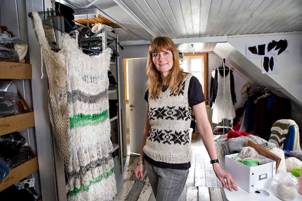 Torshavn, Streymoy Island, Faroe Islands<br /> <br /> Gudrun Ludvig, 45,  stands in her old workshop in the attic of the Gudrun & Gudrun store located on the main shopping street in the center of Torshavn.   With a large new workspace across the street, Gudrun no longer uses her old workshop to knit in, but she still keeps it filled with product and wool as it was where her business began.