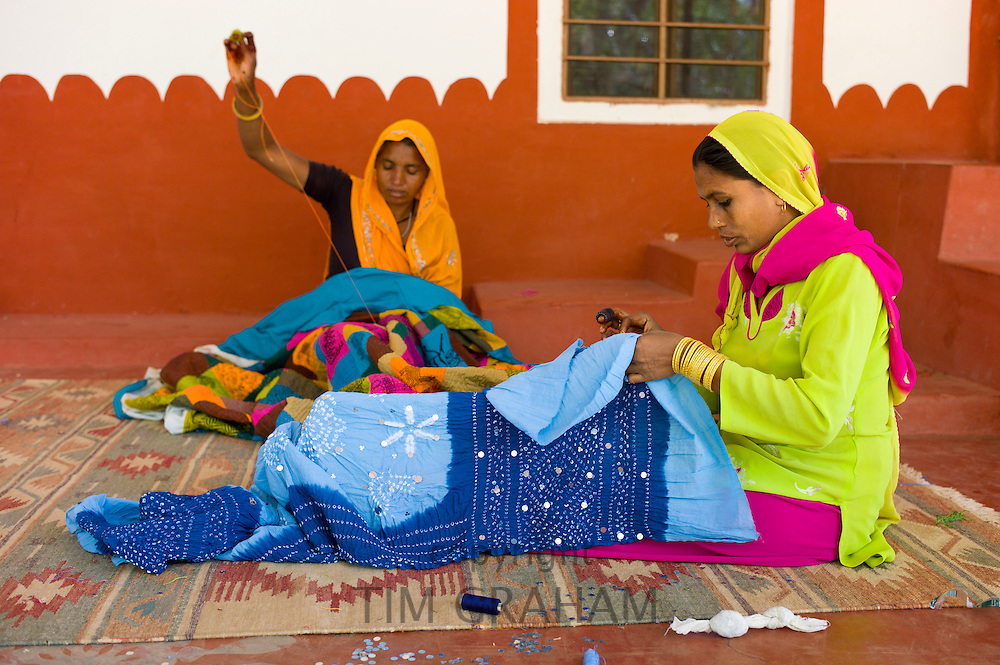 Indian women sewing textiles at Dastkar women's craft co-operative, the Ranthambore Artisan Project, in Rajasthan, Northern India RESERVED USE - NOT FOR DOWNLOAD -  FOR USE CONTACT TIM GRAHAM