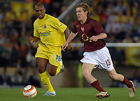 Villarreal vs Arsenal Champios league semifinals match at Villarreal the Arsenal pass to the final.-  Alexander Hleb trying to advance with the ball with the opposition of Marcos Senna