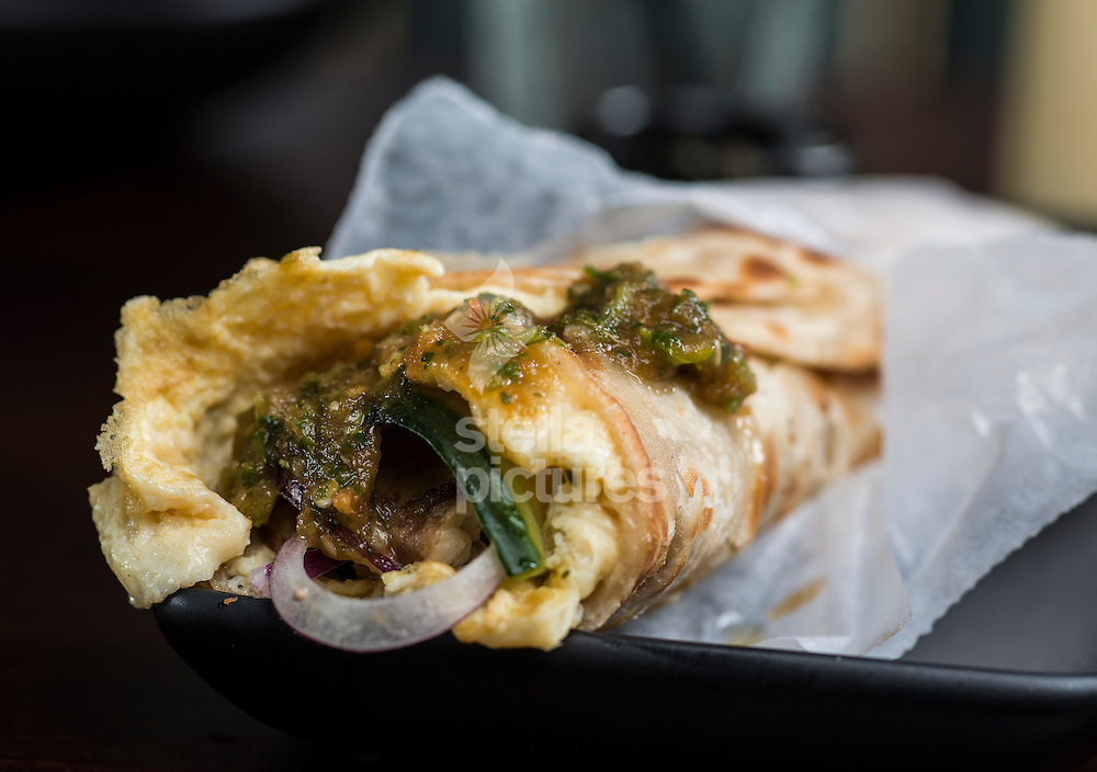 Calcutta Chicken Kathi Roll at Darjeeling Express, Soho, London <br /> Picture by Daniel Hambury/Stella Pictures Ltd +44 7813 022858<br /> 20/07/2015