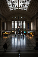Leipzig, Germany - September 6, 2015: On a Sunday morning, people walk inside the train station in Leipzig, Germany.