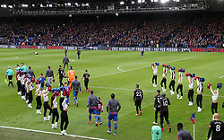 The Crystal Palace Crystals dance on the pitch prior to kick off, as players walk on