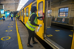 South Africa - Cape Town - 1 July 2020 - The train is disinfecting at the end of the line in Cape Town. Metrorail resumed a limited service today. Only the southern line, from Retreat to Cape Town, line was operational. Yellow circles on the platform indicates where people are allowed to stand. In the train there are also markers where to stand. Social distanced seating is made available. Picture Courtney Africa/African News Agency(ANA)