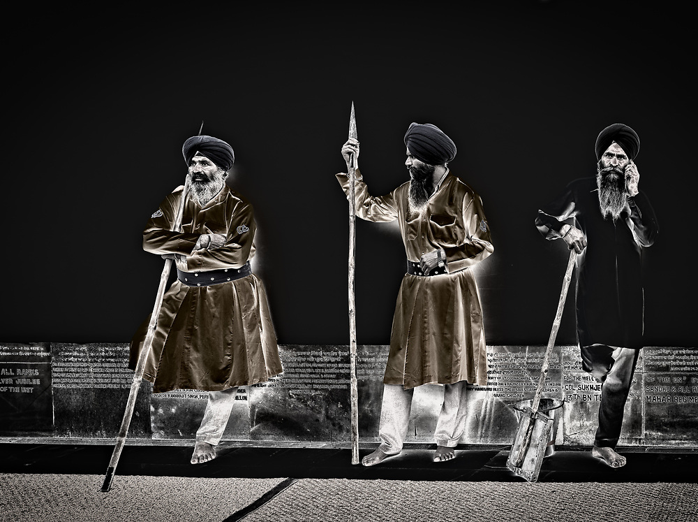 Sikh guards leaning on the wall at the Golden Temple in Amritsar