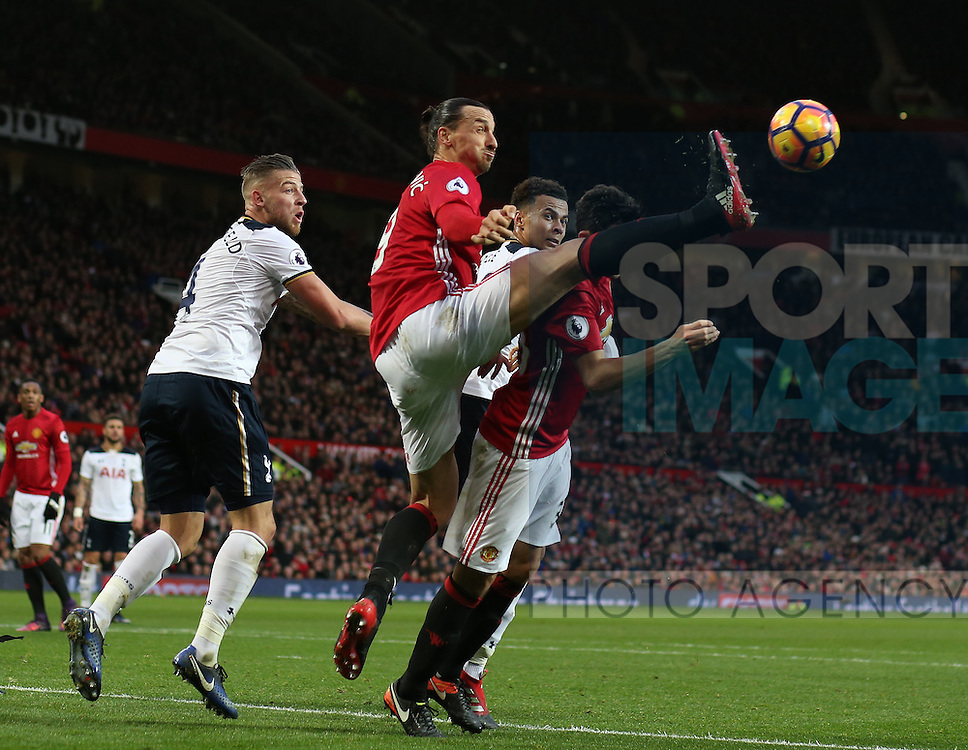 Zlatan Ibrahimovic of Manchester United gets infant of Toby Alderweireld of Tottenham to clear the ball during the English Premier League match at Old Trafford Stadium, Manchester. Picture date: December 11th, 2016. Pic Simon Bellis/Sportimage