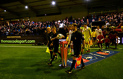 Players from both teams walk-out during the Emirates FA Cup, first round match at Ewen Fields, Hyde.